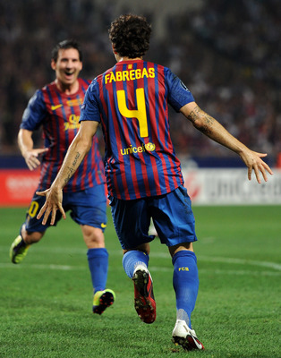 MONACO - AUGUST 26:  Cesc Fabregas (R) of FC Barcelona celebrates scoring his sides second goal with his teammate Lionel Messi during the UEFA Super Cup match between FC Barcelona and FC Porto at Louis II Stadium on August 26, 2011 in Monaco, Monaco.  (Ph