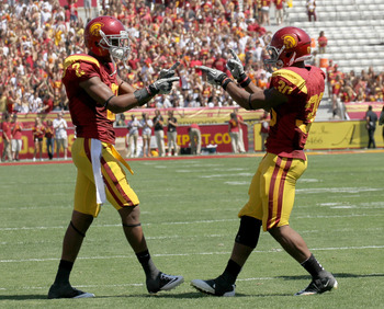 LOS ANGELES, CA - SEPTEMBER 03:  Wide receiver Robert Woods #2 of the USC Trojans celebrates with tailback D.J. Morgan #30 after making his third touchdown catch of the game against the Minnesota Golden Gophers in the second quarter at the Los Angeles Mem