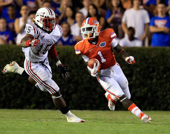 GAINESVILLE, FL - SEPTEMBER 03:  Chris Rainey #1 of the University of Florida Gators runs past Randell Johnson #15 of the Florida Atlantic University Owls during a game at Ben Hill Griffin Stadium on September 3, 2011 in Gainesville, Florida.  (Photo by S