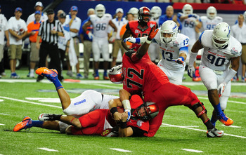 ATLANTA - SEPTEMBER 3: Aaron Murray #11 of the Georgia Bulldogs is sacked by Tyrone Crawford #40 of the Boise State Broncos during the Chick-Fil-A Kickoff Game at the Georgia Dome on September 3, 2011 in Atlanta, Georgia. Photo by Scott Cunningham/Getty I