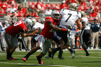 COLUMBUS, OH - SEPTEMBER 3:  Corey Brown #10 of the Ohio State Buckeyes sacks Patrick Nicely #7 of the Akron Zips during the fourth quarter on September 3, 2011 at Ohio Stadium in Columbus, Ohio. Ohio Sate defeated Akron 42-0. (Photo by Kirk Irwin/Getty I