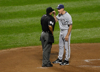NEW YORK, NY - AUGUST 19: Ron Roenicke #10 of the Milwaukee Brewers argues with home plate umpire Angel Campos #84 after Ryan Braun (not pictured) was ejected for arguing balls and strikes on August 19, 2011 at Citi Field in the Flushing neighborhood of t