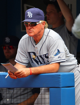 TORONTO, CANADA - AUGUST 27: Joe Maddon #70 of the Tampa Bay Rays looks on from the dugout during MLB game action against the Toronto Blue Jays on August 27, 2011 at Rogers Centre in Toronto, Ontario, Canada. (Photo by Tom Szczerbowski/Getty Images)