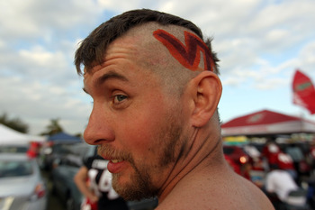 MIAMI, FL - JANUARY 03:  A fan of the Virginai Tech Hokies looks on in the parking lot prior to Virginia Tech playing against the Stanford Cardinal during the 2011 Discover Orange Bowl at Sun Life Stadium on January 3, 2011 in Miami, Florida.  (Photo by M
