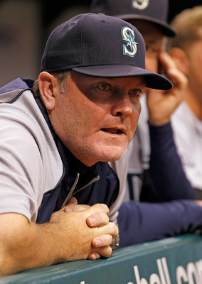 ST. PETERSBURG, FL - AUGUST 20:  Manager Eric Wedge #22 of the Seattle Mariners watches his team against the Tampa Bay Rays during the game at Tropicana Field on August 20, 2011 in St. Petersburg, Florida.  (Photo by J. Meric/Getty Images)