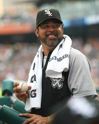 DETROIT, MI - SEPTEMBER 03:  Manager Ozzie Guillen #13 of the Chicago White Sox gets ready to toss a baseball to a fan during a MLB game against the Detroit Tigers at Comerica Park on September 3, 2011 in Detroit, Michigan.  (Photo by Dave Reginek/Getty I