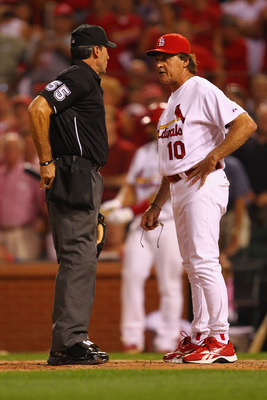 ST. LOUIS, MO - AUGUST 9: Tony La Russa #10 of the St. Louis Cardinals argues a call with umpire Angel Hernandez #55 against the Milwaukee Brewers at Busch Stadium on August 9, 2011 in St. Louis, Missouri.  The Brewers beat the Cardinals 5-3 in 10 innings