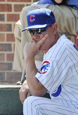 CHICAGO, IL - AUGUST 19:  Manager Mike Quade #8 of the Chicago Cubs sits in the dugout during the second inning against the St. Louis Cardinals at Wrigley Field on August 19, 2011 in Chicago, Illinois.  (Photo by Brian Kersey/Getty Images)