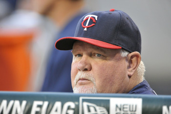 CHICAGO, IL - AUGUST 29:  Manager Ron Gardenhire #35 of the Minnesota Twins stands in the dugout before the game against the Chicago White Sox at U.S. Cellular Field on August 29, 2011 in Chicago, Illinois.  (Photo by Brian Kersey/Getty Images)