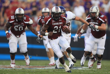 CHARLOTTE, NC - SEPTEMBER 03:  Marcus Lattimore #21 of the South Carolina Gamecocks runs with the ball against the East Carolina Pirates during their game at Bank of America Stadium on September 3, 2011 in Charlotte, North Carolina.  (Photo by Streeter Le