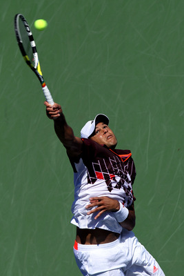 NEW YORK, NY - AUGUST 30:  Jo-Wilfried Tsonga of France serves against Yen-Hsun Lu of Taiwan during Day Two of the 2011 US Open at the USTA Billie Jean King National Tennis Center on August 30, 2011 in the Flushing neighborhood of the Queens borough of Ne