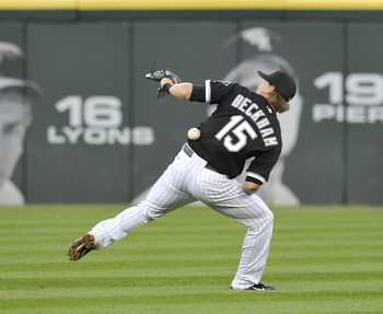 CHICAGO, IL - JULY 25: Gordon Beckham #15 of the Chicago White Sox commits an error in the third inning against the Detroit Tigers on July 25, 2011 at U.S. Cellular Field in Chicago, Illinois.  (Photo by David Banks/Getty Images)