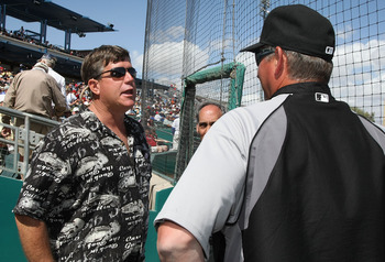 TUCSON, AZ - MARCH 07:  John Green (L), fathter to Christina-Taylor Green, talks with batting coach Greg Walker of the Chicago White Sox before the spring training game between the Chicago White Sox and the Arizona Diamondbacks at Kino Veterans Memorial S