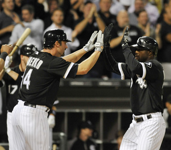 CHICAGO, IL - AUGUST 30: Alejandro De Aza #30 of the Chicago White Sox is greeted by Paul Konerko #14 after hitting a three-run homer in the fourth inning against the Minnesota Twins on August 30, 2011 at U.S. Cellular Field in Chicago, Illinois.  (Photo