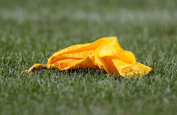 CHICAGO - AUGUST 28: A penalty flag lays on the ground during a preseason game between the Chicago Bears and the Arizona Cardinals during a preseason game at Soldier Field on August 28, 2010 in Chicago, Illinois. The Cardinals defeated the Bears 14-9. (Ph