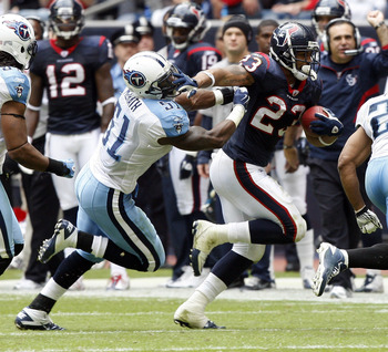 HOUSTON - NOVEMBER 28:  Running back Arian Foster #23 of the Houston Texans gives linebacker Gerlad McRath #51 of the Tennessee Titans a stiff arm to the face as he rushes in the second quarter at Reliant Stadium on November 28, 2010 in Houston, Texas.  (