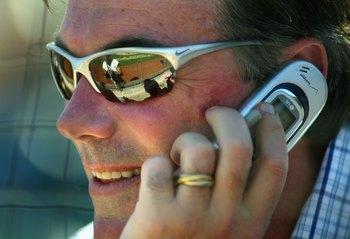 PHOENIX - MARCH 03:  General manager Billy Beane of the Oakland Athletics talks on the phone during the MLB Spring Training game against the Milwaukee Brewers at Phoenix Municipal Stadium on March 3, 2006 in Phoenix, Arizona.  The Brewers defeated the A's