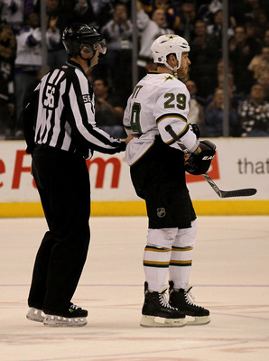LOS ANGELES, CA - MARCH 7:  Linesman Mark Wheeler skates Steve Ott #29 of the Dallas Stars off the ice after Ott received a game misconduct penalty for spearing against the Los Angeles Kings at Staples Center on March 7, 2011 in Los Angeles, California.