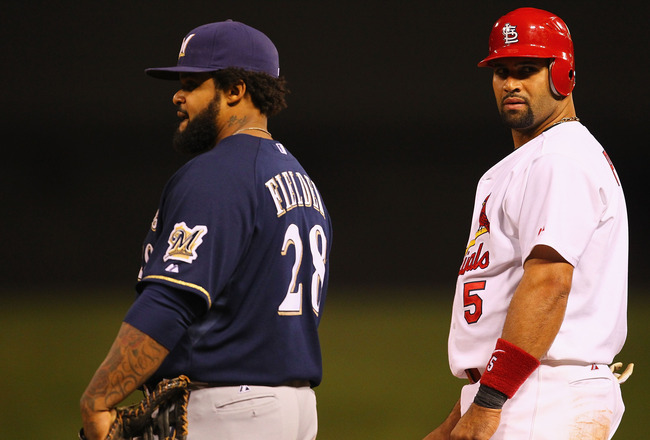 ST. LOUIS, MO -SEPTEMBER 7: Prince Fielder #28 of the Milwaukee Brewers and Albert Pujols #5 of the St. Louis Cardinals stand on first base at Busch Stadium on September 7, 2011 in St. Louis, Missouri.  The Cardinals beat the Brewers 2-0.  (Photo by Dilip