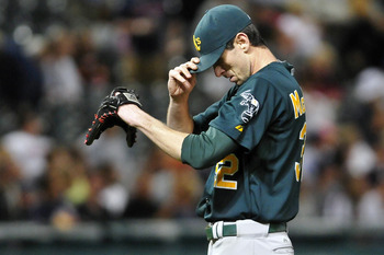 CLEVELAND, OH - AUGUST 29: Starting pitcher Brandon McCarthy #32 of the Oakland Athletics reacts after giving up a run during the sixth inning against the Cleveland Indians at Progressive Field on August 29, 2011 in Cleveland, Ohio. (Photo by Jason Miller