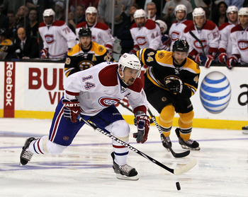 BOSTON, MA - APRIL 27:  Dennis Seidenberg #44 of the Boston Bruins cannot stop Tomas Plekanec #14 of the Montreal Canadiens who scored a goal on the play in Game Seven of the Eastern Conference Quarterfinals during the 2011 NHL Stanley Cup Playoffs at TD