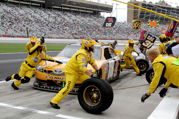 HAMPTON, GA - SEPTEMBER 06:  Kyle Busch, driver of the #18 Pedigree Toyota, makes a pit stop during the NASCAR Sprint Cup Series AdvoCare 500 at Atlanta Motor Speedway on September 6, 2011 in Hampton, Georgia.  (Photo by Jerry Markland/Getty Images for NA