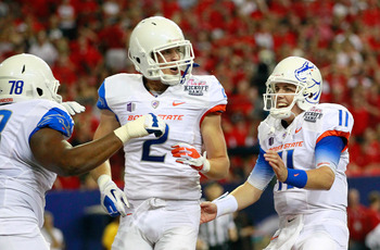 ATLANTA, GA - SEPTEMBER 03:  Kellen Moore #11 celebrates with Matt Miller #2 of the Boise State Broncos after they connected for a touchdown against the Georgia Bulldogs at Georgia Dome on September 3, 2011 in Atlanta, Georgia.  (Photo by Kevin C. Cox/Get