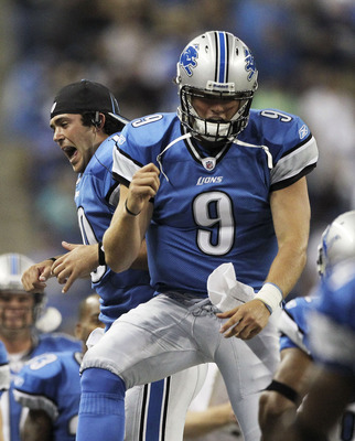 Former Detroit Lions quarterback Zac Robinson dances with Matthew Stafford.