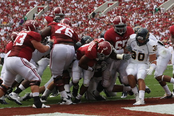 TUSCALOOSA, AL - SEPTEMBER 3:  Runningback Trent Richardson #3 of the Alabama Crimson Tide scores on a one yard run early in the first quarter in the game with the Kent State Golden Flashes on September 3, 2011 at Bryant Denny Stadium in Tuscaloosa, Alaba