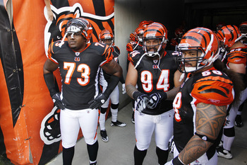 CINCINNATI, OH - SEPTEMBER 1: Anthony Collins #73, Domata Peko #94 and Rey Maualuga #58 of the Cincinnati Bengals get set to lead the team onto the field before an NFL preseason game against the Indianapolis Colts at Paul Brown Stadium on September 1, 201