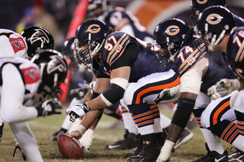 CHICAGO - DECEMBER 18:  Center Olin Kreutz #57 of the Chicago Bears prepares to snap the ball against the Atlanta Falcons at Soldier Field on December 18, 2005 in Chicago, Illinois. The Bears defeated the Falcons 16-3. (Photo by Jonathan Daniel/Getty Imag