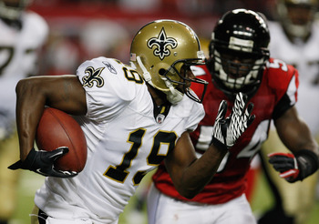 ATLANTA, GA - DECEMBER 27:  Devery Henderson #19 of the New Orleans Saints runs past Atlanta Falcons defender Stephen Nicholas #54 in the second half during their game at the Georgia Dome on December 27, 2010 in Atlanta, Georgia.  (Photo by Scott Halleran