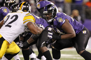 BALTIMORE, MD - DECEMBER 05:  Michael Oher #74 of the Baltimore Ravens blocks James Harrison #92 of the Pittsburgh Steelers at M&T Bank Stadium on December 5, 2010 in Baltimore, Maryland.  (Photo by Geoff Burke/Getty Images)