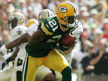 GREEN BAY, WI - SEPTEMBER 17:  Punt returner Charles Woodson #21 of the Green Bay Packers runs with the ball during the game against the New Orleans Saints on September 17, 2006 at Lambeau Field in Green Bay, Wisconsin. The Saints defeated the Packers 34-
