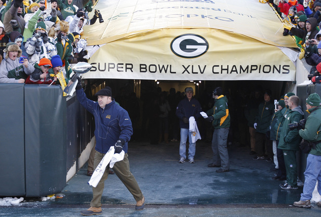 GREEN BAY, WI - FEBRUARY 08: Green Bay Packers head coach Mike McCarthy carries the Lombardi Trophy onto Lambeau Field during the Packers victory ceremony on February 8, 2011 in Green Bay, Wisconsin.  (Photo by Matt Ludtke/Getty Images)