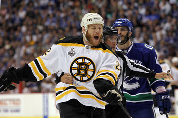 VANCOUVER, BC - JUNE 10:  Shawn Thornton #22 of the Boston Bruins and Maxim Lapierre #40 of the Vancouver Canucks are separated during Game Five of the 2011 NHL Stanley Cup Final at Rogers Arena on June 10, 2011 in Vancouver, British Columbia, Canada.  (P