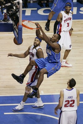 AUBURN HILLS, MI - MAY 3:  Dwight Howard #12 of the Orlando Magic dunks against Rasheed Wallace #36 and Tayshaun Prince #22 of the Detroit Pistons in Game One of the Eastern Conference Semifinals during the 2008 NBA Playoffs at the Palace of Auburn Hills