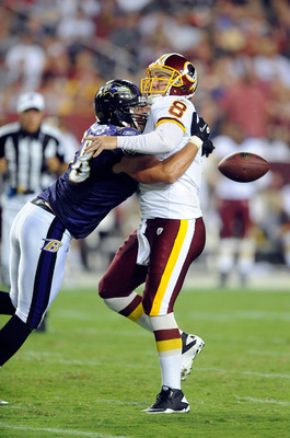LANDOVER, MD - AUGUST 21:  Rex Grossman #8 of the Washington Redskins fumbles the ball after a sack during the preseason game by Jason Phillips #58 of the Baltimore Ravens at FedExField on August 21, 2010 in Landover, Maryland.  (Photo by Greg Fiume/Getty