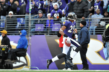 BALTIMORE, MD - NOVEMBER 7:  Cary Williams #29 of the Baltimore Ravens runs the ball after a fake punt against the Miami Dolphins at M&T Bank Stadium on November 7, 2010 in Baltimore, Maryland. The Ravens defeated the Dolphins 26-10. (Photo by Larry Frenc