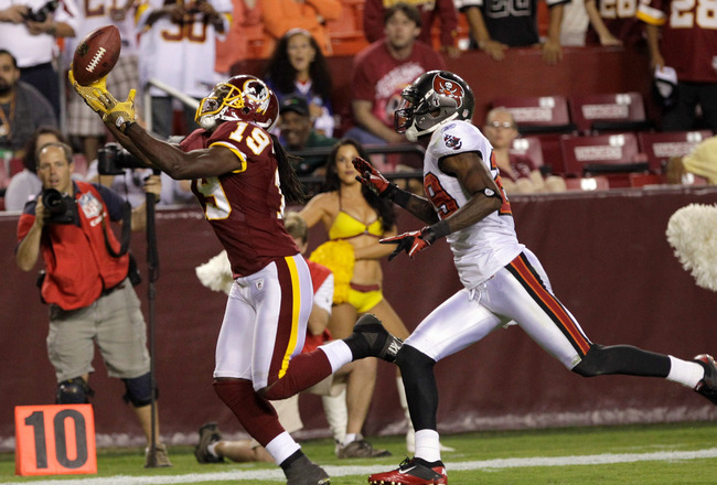 LANDOVER, MD - SEPTEMBER 01: Wide receiver  Donte' Stallworth #19 of the Washington Redskins catches a pass for the game winning touchdown in front of  DJ Johnson #29 of the Tampa Bay Buccaneers during the second  half of a preseason game at FedExField on