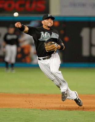 MIAMI GARDENS, FL - AUGUST 24: Omar Infante #13 of the Florida Marlins makes a throw to first during game two of a doubleheader against the Cincinnati Reds at Sun Life Stadium on August 24, 2011 in Miami Gardens, Florida.  (Photo by Mike Ehrmann/Getty Ima