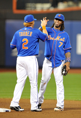 NEW YORK, NY - SEPTEMBER 1: Jose Reyes #7 and Justin Turner #2 of the New York Mets congratulate one another after defeating the Florida Marlins 7-5 at Citi Field on September 1, 2011 in the Flushing neighborhood of the Queens borough of New York City. (P