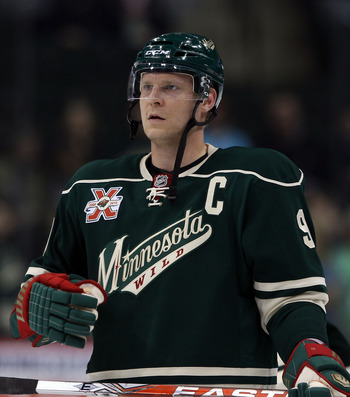 ST PAUL, MN - MARCH 22:  Mikko Koivu #9 of the Minnesota Wild skates against the Toronto Maple Leafs at the Xcel Energy Center on March 22, 2011 in St Paul, Minnesota.  (Photo by Bruce Bennett/Getty Images)