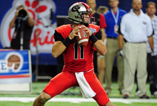ATLANTA - SEPTEMBER 3: Aaron Murray #11 of the Georgia Bulldogs passes against the Boise State Broncos during the Chick-Fil-A Kickoff Game at the Georgia Dome on September 3, 2011 in Atlanta, Georgia. Photo by Scott Cunningham/Getty Images)