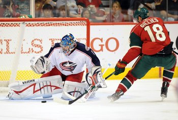 ST. PAUL, MN - SEPTEMBER 18: Colton Gillies #18 of the Minnesota Wild shoots the puck against Steve Mason #1 of the Columbus Blue Jackets during the first period of a preseason game on September 18, 2009 at the Xcel Energy Center in St. Paul, Minnesota. (