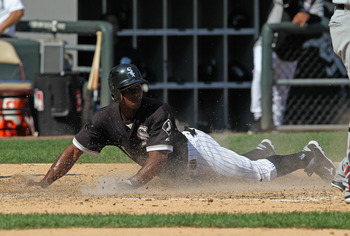 CHICAGO, IL - AUGUST 31:  Juan Pierre #1 of the Chicago White Sox slides across home plate to score a run against the Minnesota Twins at U.S. Cellular Field on August 31, 2011 in Chicago, Illinois. The Twins defeated the White Sox 7-6.  (Photo by Jonathan