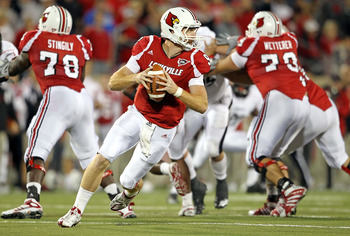 LOUISVILLE, KY - OCTOBER 15:  Adam Froman #9 of  the Louisville Cardinals runs with the ball during the Big East Conference game against the Cincinnati Bearcats at Papa John's Cardinal Stadium on October 15, 2010 in Louisville, Kentucky.  (Photo by Andy L