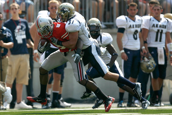 COLUMBUS, OH - SEPTEMBER 3:  Verlon Reed #9 of the Ohio State Buckeyes is tackled by Seth Cunningham #37 of the Akron Zips during the first quarter on September 3, 2011 at Ohio Stadium in Columbus, Ohio. Ohio State defeated Akron 42-0. (Photo by Kirk Irwi