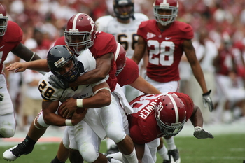 TUSCALOOSA, AL - SEPTEMBER 3:  Defensive back DeQuan Menzie #24 and linebacker Dont'a Hightower of the Alabama Crimson Tide tackles runningback Anthony Meray #28 of the Kent State Golden Flashes during first half action on September 3, 2011 at Bryant Denn
