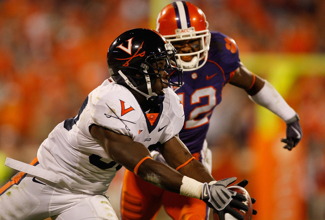 CLEMSON, SC - NOVEMBER 21:  Perry Jones #33 of the Virginia Cavaliers catches a ball as Marcus Gilchrist #12 of the Clemson Tigers tries to catch him during their game at Memorial Stadium on November 21, 2009 in Clemson, South Carolina.  (Photo by Streete